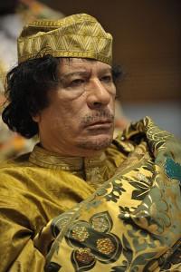 Муаммар Каддафи.U.S. Navy, photo by Jesse B. Awalt